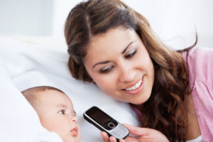 mom baby and the phone between them